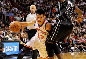 MIAMI, FL - FEBRUARY 23:  Jeremy Lin #17 of the New York Knicks drives against Joel Anthony #50 of the Miami Heat during a game  at American Airlines Arena on February 23, 2012 in Miami, Florida. NOTE TO USER: User expressly acknowledges and agrees that,