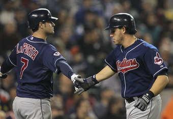 DETROIT - SEPTEMBER 28: Asdrubal Cabrera #13 of the Cleveland Indians is congratulated by teammate Matt LaPorta #7 after scoring on a single to left center field off the bat of Jack Hannahan of the Detroit Tigers during the fifth inning of the game at Com