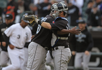 CHICAGO, IL - SEPTEMBER 28: J.P Arencibia #9 of the Toronto Blue Jays hugs teammate Frank Francisco #50 after winning the last game of the season against the Chicago White Sox at U.S. Cellular Field on September 28, 2011 in Chicago, Illinois. The Blue Jay