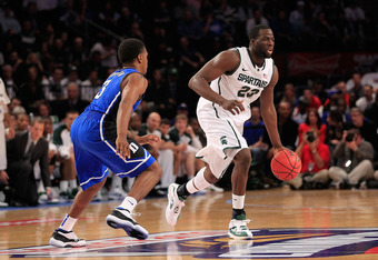 NEW YORK - NOVEMBER 15:  Draymond Green #23 of the Michigan State Spartans drives the ball against Tyler Thornton #3 of the Duke Blue Devils during the 2011 State Farms Champions Classic at Madison Square Garden on November 15, 2011 in New York City.  (Ph