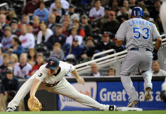 Chris Parmelee stretches for a low throw in 2011