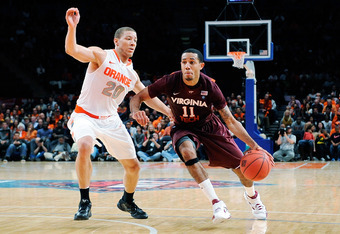 NEW YORK, NY - NOVEMBER 23:  Erick Green #11 of the Virginia Tech Hokies drives the ball against Brandon Triche #20 of the Syracuse Orange during the 2011 Dick's Sporting Goods NIT Season Tip-Off at Madison Square Garden on November 23, 2011 in New York C