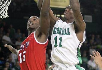 Nigel Spikes brings down a rebound against the Houston Cougars on February 22nd. Marshall faces the Memphis Tigers on Saturday the 25th (credit Herald Dispatch)