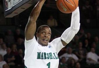 Dennis Tinnon goes up for a slam dunk during Marshall's win over the Houston Cougars on February 22nd (credit Herald Dispatch)