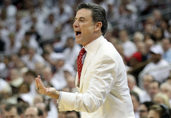 LOUISVILLE, KY - FEBRUARY 13:  Rick Pitino the head coach of the Louisville Cardinals gives instructions to his team during the Big East Conference game against the Syracuse Orange at KFC YUM! Center on February 13, 2012 in Louisville, Kentucky.  (Photo b