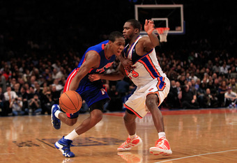 NEW YORK, NY - JANUARY 31:  Brandon Knight #7 of the Detroit Pistons drives past Toney Douglas #23 of the New York Knicks at Madison Square Garden on January 31, 2012 in New York City. NOTE TO USER: User expressly acknowledges and agrees that, by download