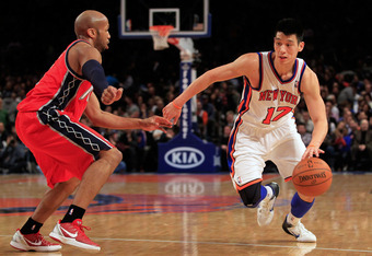 NEW YORK, NY - FEBRUARY 20: Jeremy Lin #17 of the New York Knicks drives against Sundiata Gaines #1 of the New Jersey Nets at Madison Square Garden on February 20, 2012 in New York City. NOTE TO USER: User expressly acknowledges and agrees that, by downlo