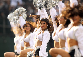 OAKLAND, CA - NOVEMBER 27:  The Oakland Raiders cheerleaders, the Raiderettes, cheer on their team during their game against the Chicago Bears at O.co Coliseum on November 27, 2011 in Oakland, California.  (Photo by Ezra Shaw/Getty Images)