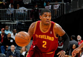 ATLANTA, GA - JANUARY 21:  Kyrie Irving #2 of the Cleveland Cavaliers against Jeff Teague #0 of the Atlanta Hawks at Philips Arena on January 21, 2012 in Atlanta, Georgia.  NOTE TO USER: User expressly acknowledges and agrees that, by downloading and or u