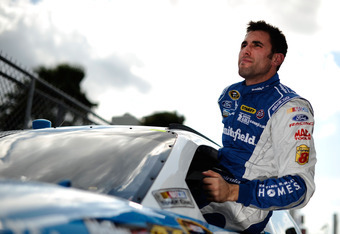 DAYTONA BEACH, FL - FEBRUARY 19:  Aric Almirola, driver of the #43 Smithfield Ford, gets out of his car during qualifying for the NASCAR Sprint Cup Series Daytona 500 at Daytona International Speedway on February 19, 2012 in Daytona Beach, Florida.  (Phot