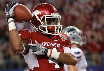 ARLINGTON, TX - JANUARY 06:  Jarius Wright #4 of the Arkansas Razorbacks celebrates a touchdown pass reception against the Kansas State Wildcats during the Cotton Bowl at Cowboys Stadium on January 6, 2012 in Arlington, Texas.  (Photo by Ronald Martinez/G