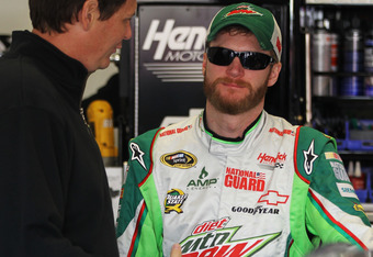 DAYTONA BEACH, FL - FEBRUARY 25:  Dale Earnhardt Jr., driver of the #88 Diet Mountain Dew/National Guard Chevrolet, speaks to crew chief Steve Letarte in the garage during practice for the NASCAR Sprint Cup Series Daytona 500 at Daytona International Spee