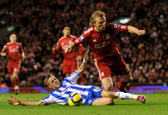 LIVERPOOL, ENGLAND - FEBRUARY 19:  Craig Noone of Brighton & Hove Albion brings down Dirk Kuyt of Liverpool to concede a penalty kick during the FA Cup Fifth Round match between Liverpool and Brighton & Hove Albion at Anfield on February 19, 2012 in Liver