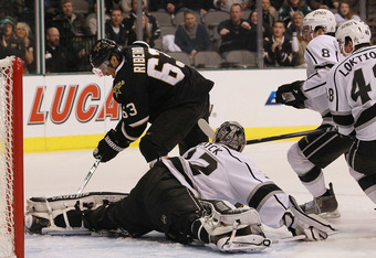 DALLAS, TX - FEBRUARY 12:  Jonathan Quick #32 of the Los Angeles Kings makes a save against Mike Ribeiro #63 of the Dallas Stars at American Airlines Center on February 12, 2012 in Dallas, Texas.  (Photo by Ronald Martinez/Getty Images)