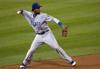 SAN DIEGO, CA - SEPTEMBER 26: Starlin Castro #13 of the Chicago Cubs fields the ball and throws to first base for the out during the first inning of the game against the San Diego Padres at Petco Park on September 26, 2011 in San Diego, California. (Photo