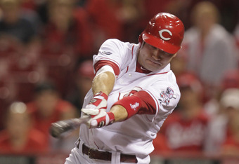 CINCINNATI, OH - SEPTEMBER 20: Joey Votto #19 of the Cincinnati Reds bats against the Houston Astros at Great American Ball Park on September 20, 2011 in Cincinnati, Ohio.  (Photo by John Sommers II/Getty Images)