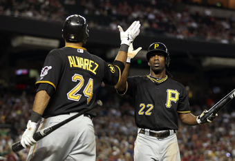 PHOENIX, AZ - SEPTEMBER 20:  Andrew McCutchen #22 of the Pittsburgh Pirates high fives Pedro Alvarez #24 after scoring agianst the Arizona Diamondbacks during the fifth inning of the Major League Baseball game at Chase Field on September 20, 2011 in Phoen