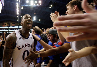 LAWRENCE, KS - FEBRUARY 25:  Thomas Robinson #0 of the Kansas Jayhawks reacts after the Jayhawks defeated the Missouri Tigers 87-86 to win the game on February 25, 2012 at Allen Fieldhouse in Lawrence, Kansas.  (Photo by Jamie Squire/Getty Images)