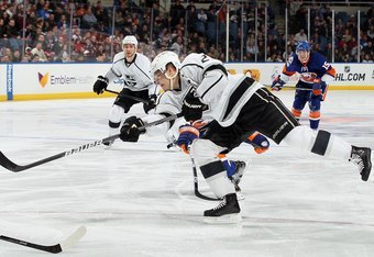 UNIONDALE, NY - FEBRUARY 11:  Dustin Brown #23 of the Los Angeles Kings in action against the New York Islanders on February 11, 2012 at Nassau Coliseum in Uniondale, New York. The Islanders defeated the Kings 2-1 in overtime.  (Photo by Jim McIsaac/Getty
