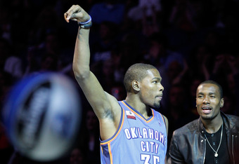 ORLANDO, FL - FEBRUARY 25:  Kevin Durant of the Oklahoma City Thunder is supported by teammate Serge Ibaka (R) as Durant competes during the Foot Locker Three-Point Contest part of 2012 NBA All-Star Weekend at Amway Center on February 25, 2012 in Orlando,