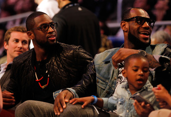 ORLANDO, FL - FEBRUARY 25:  (L-R) Dwyane Wade and LeBron James sit courtside during the Taco Bell Skills Challenge part of 2012 NBA All-Star Weekend at Amway Center on February 25, 2012 in Orlando, Florida.  NOTE TO USER: User expressly acknowledges and a