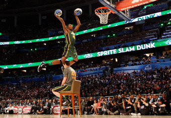 ORLANDO, FL - FEBRUARY 25:  Jeremy Evans of the UTah Jazz  jumps over jumps over teammate Gordon Haywood as he dunks two basketballs during the Sprite Slam Dunk Contest part of 2012 NBA All-Star Weekend at Amway Center on February 25, 2012 in Orlando, Flo