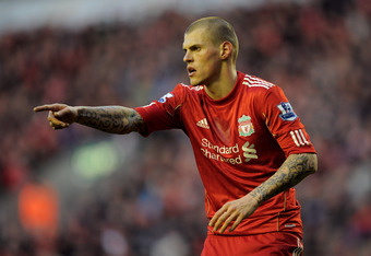 LIVERPOOL, ENGLAND - FEBRUARY 19:  Martin Skrtel of Liverpool gestures during the FA Cup Fifth Round match between Liverpool and Brighton & Hove Albion at Anfield on February 19, 2012 in Liverpool, England. (Photo by Michael Regan/Getty Images)