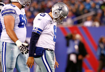 EAST RUTHERFORD, NJ - JANUARY 01:   Tony Romo #9 of the Dallas Cowboys walks back to the bench against the New York Giants at MetLife Stadium on January 1, 2012 in East Rutherford, New Jersey.  (Photo by Jeff Zelevansky/Getty Images)
