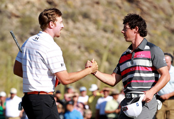 MARANA, AZ - FEBRUARY 26: (L-R) Hunter Mahan of the United States shakes hands with Rory McIlroy of Northern Ireland after winning the championship match 2 and 1 on the 17th hole during the final round of the World Golf Championships-Accenture Match Play