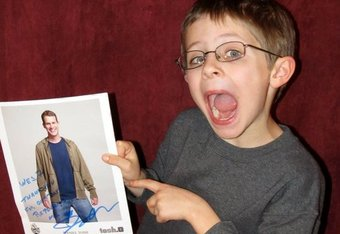 "Wesley with an autographed photo from Daniel Tosh. Tosh writes ""Wes.7, Thank you for one day replacing me."" Courtesy of Facebook.com/WesPoint7."