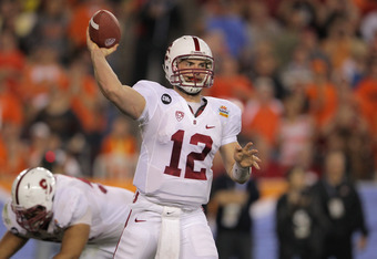 GLENDALE, AZ - JANUARY 02:  Andrew Luck #12 of the Stanford Cardinal throws a pass against the Oklahoma State Cowboys during the Tostitos Fiesta Bowl on January 2, 2012 at University of Phoenix Stadium in Glendale, Arizona. Oklahoma State won 41-38 in ove