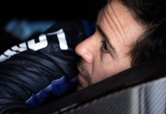 DAYTONA BEACH, FL - FEBRUARY 25:  Jimmie Johnson, driver of the #48 Lowe's Chevrolet, sits in his car in the garage area during practice for the NASCAR Sprint Cup Series Daytona 500 at Daytona International Speedway on February 25, 2012 in Daytona Beach,