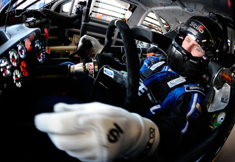 DAYTONA BEACH, FL - FEBRUARY 24:  Carl Edwards, driver of the #99 Fastenal Ford, sits in his car in the garage during practice for the NASCAR Sprint Cup Series Daytona 500 at Daytona International Speedway on February 24, 2012 in Daytona Beach, Florida.