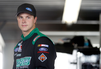 DAYTONA BEACH, FL - FEBRUARY 23:  Trevor Bayne, driver of the #60 Roush Fenway Racing Ford, looks on in the garage during practice for the NASCAR Nationwide Series DRIVE4COPD 300 at Daytona International Speedway on February 23, 2012 in Daytona Beach, Flo