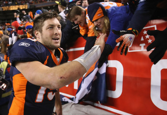 DENVER, CO - JANUARY 08:  Quarterback Tim Tebow #15 of the Denver Broncos receives high fives from fans after defeating the Pittsburgh Steelers in overtime of the AFC Wild Card Playoff game at Sports Authority Field at Mile High on January 8, 2012 in Denv