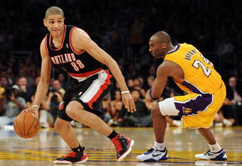 LOS ANGELES, CA - FEBRUARY 20:  Nicolas Batum #88 of the Portland Trail Blazers dribbles past Kobe Bryant #24 of the Los Angeles Lakers during the game at Staples Center on February 20, 2012 in Los Angeles, California.  NOTE TO USER: User expressly acknow