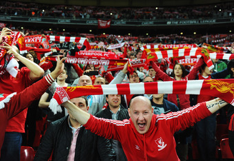 LONDON, ENGLAND - FEBRUARY 26:  Liverpool fans celebrate after victory in the Carling Cup Final match between Liverpool and Cardiff City at Wembley Stadium on February 26, 2012 in London, England. Liverpool won 3-2 on penalties.  (Photo by Mike Hewitt/Get