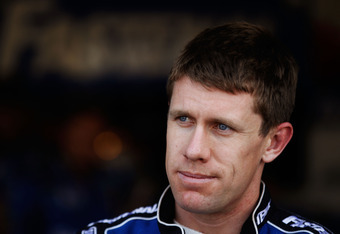 DAYTONA BEACH, FL - FEBRUARY 24:  Carl Edwards, driver of the #99 Fastenal Ford, stands in the garage during practice for the NASCAR Sprint Cup Series Daytona 500 at Daytona International Speedway on February 24, 2012 in Daytona Beach, Florida.  (Photo by