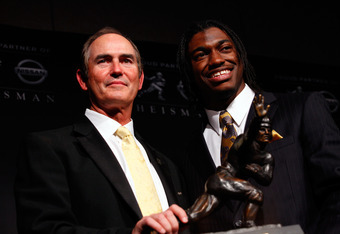 NEW YORK, NY - DECEMBER 10:  (L-R) Coach Art Briles and Robert Griffin III of the Baylor Bears poses with the trophy after being named the 77th Heisman Memorial Trophy Award winner during a press conference at The New York Marriott Marquis on December 10,