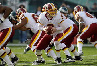 PHILADELPHIA, PA - JANUARY 01:  Quarterback Rex Grossman #8 of the Washington Redskins hands the ball off against the Philadelphia Eagles at Lincoln Financial Field on January 1, 2012 in Philadelphia, Pennsylvania.  (Photo by Rob Carr/Getty Images)
