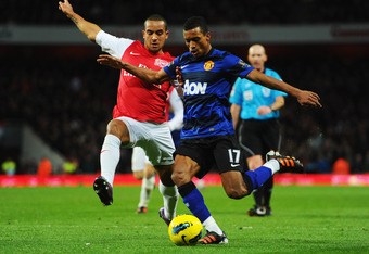 LONDON, ENGLAND - JANUARY 22:  Theo Walcott of Arsenal challenges Luis Nani of Manchester United during the Barclays Premier League match between Arsenal and Manchester United at Emirates Stadium on January 22, 2012 in London, England.  (Photo by Mike Hew