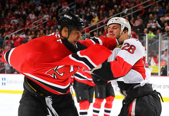 NEWARK, NJ - DECEMBER 08:  Mark Fraser #2 of the New Jersey Devils fights Zenon Konopka #28 of the Ottawa Senators during their game on December 8, 2011 at The Prudential Center in Newark, New Jersey  (Photo by Al Bello/Getty Images)