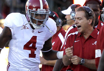 OXFORD, MS - OCTOBER 15:  Coach Nick Saban of the Alabama Crimson Tide talks with defensive back Mark Barron #4 of the Alabama Crimson Tide after the Ole Miss Rebels scored on the opening drive on October 15, 2011 at Vaught-Hemingway Stadium in Oxford, Mi