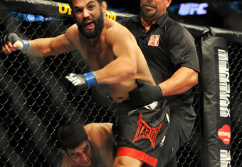 PHILADELPHIA - AUGUST 08:  (Front)  Johny Hendricks battles Amir Sadollah during their Welterweight bout at UFC 101: Declaration at the Wachovia Center on August 8, 2009 in Philadelphia, Pennsylvania.  Hendricks defeated Amir Sadollah by unanimous decisio