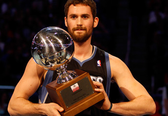 ORLANDO, FL - FEBRUARY 25:  Kevin Love of the Minnesota Timberwolves celebrates with the trophy after he won the Foot Locker Three-Point Contest part of 2012 NBA All-Star Weekend at Amway Center on February 25, 2012 in Orlando, Florida.  NOTE TO USER: Use