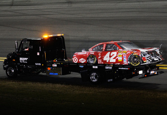 DAYTONA BEACH, FL - FEBRUARY 27:  The wrecked #42 Target Chevrolet driven by Juan Pablo Montoya is towed back to the garage after crashing into a jet dryer under caution during the NASCAR Sprint Cup Series Daytona 500 at Daytona International Speedway on