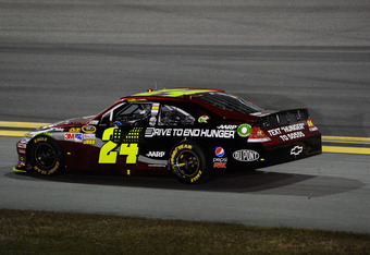 DAYTONA BEACH, FL - FEBRUARY 27:  Jeff Gordon, driver of the #24 Drive to End Hunger Chevrolet, drives back to the garage on the apron after his engine failed during the NASCAR Sprint Cup Series Daytona 500 at Daytona International Speedway on February 27