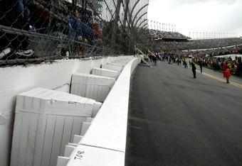 The Daytona wall and fans were ready Sunday for racing, but rain postponed the event.