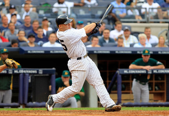 NEW YORK, NY - AUGUST 25: Russell Martin #55 of the New York Yankees hits a grand slam home run in the 6th inning against the Oakland Athletics on August 25, 2011 at Yankee Stadium in the Bronx borough of New York City.  (Photo by Chris Trotman/Getty Imag