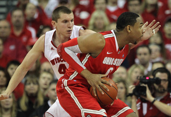 MADISON, WI - FEBRUARY 04:  Jared Sullinger #0 of the Ohio State Buckeyes moves against Jared Berggren #40 of the Wisconsin Badgers at Kohl Center on February 4, 2012 in Madison, Wisconsin. Ohio State defeated Wisconsin 58-52.  (Photo by Jonathan Daniel/G